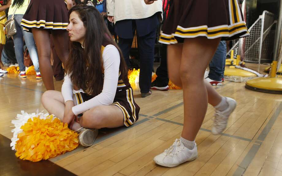 Cheerleaders who participate in sideline cheer, but not competition cheerleading, would not be helped by a bill in the state Assembly that seeks to make cheerleading safer. Photo: Jessica Christian, The Chronicle