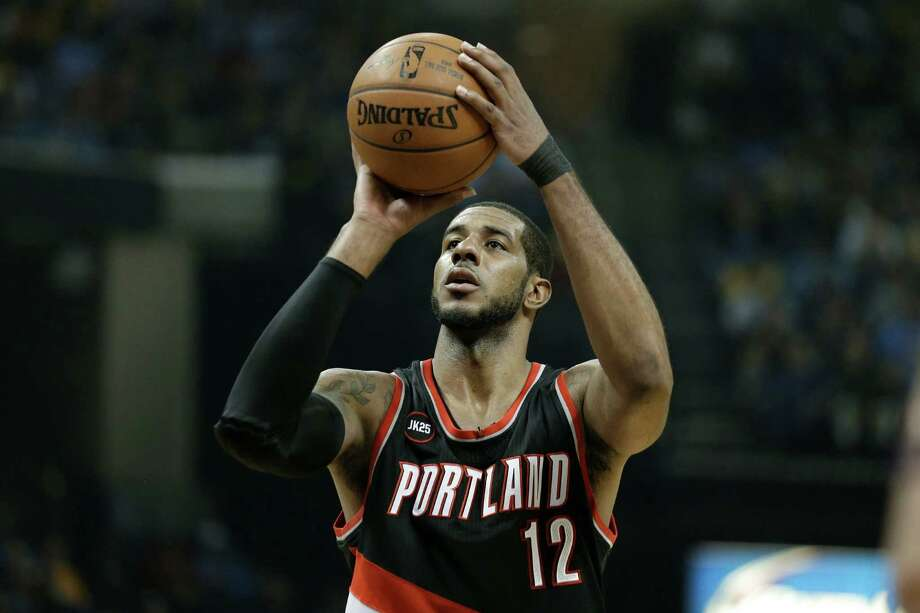 Portland Trail Blazers forward LaMarcus Aldridge shoots a free throw against the Memphis Grizzlies in the first half of Game 2 of an NBA basketball Western Conference playoff series Wednesday, April 22, 2015, in Memphis, Tenn. (AP Photo/Mark Humphrey) Photo: Mark Humphrey, STF / Associated Press / AP