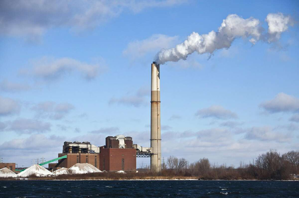 This Dec. 13, 2010, file photo shows CMS Energy Corp.'s B.C. Cobb Plant in Muskegon, Mich. The week of Monday, June 29, 2015, the U.S. Supreme Court is expected to rule on a challenge by Michigan and 20 other states to new U.S. Environmental Protection Agency regulations of mercury and other toxic air pollutants at coal fired power plants. live. (Jeffrey Ball, The Muskegon Chronicle via AP)