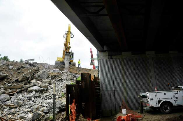 With the new bridge in place, on right in photo, crews work to demolish the northbound bridge at Exit 4 of Interstate 87 on Monday, June 29, 2015, in Colonie, N.Y.   (Paul Buckowski / Times Union) Photo: PAUL BUCKOWSKI / 00032427A