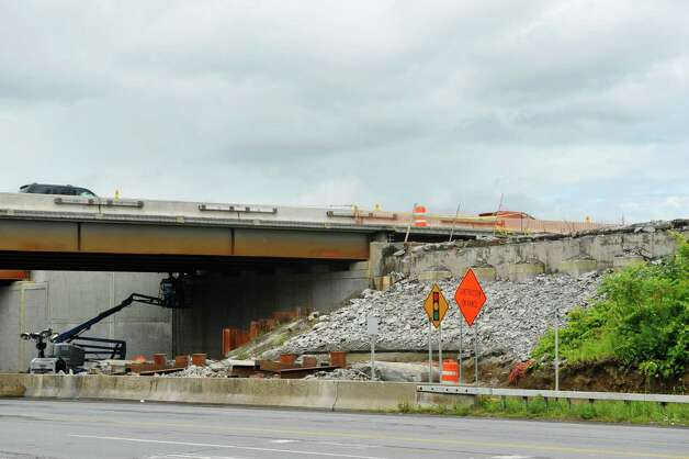With the new bridge in place, on left in photo, crews work to demolish the northbound bridge at Exit 4 of Interstate 87 on Monday, June 29, 2015, in Colonie, N.Y.   (Paul Buckowski / Times Union) Photo: PAUL BUCKOWSKI / 00032427A