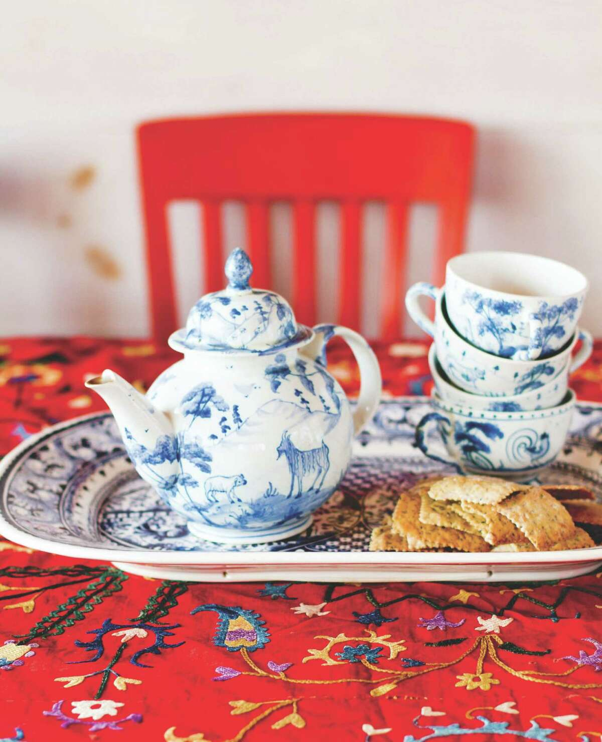 """A mix of red, white and blue doesn't have to look like the Fourth of July. This tea set and tablecloth, below, from """"Crafting a Colorful Home"""" by Kristin Nicholas, are more Asian than Americana."""