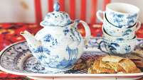 "A mix of red, white and blue doesn't have to look like the Fourth of July. This tea set and tablecloth, below, from ""Crafting a Colorful Home"" by Kristin Nicholas, are more Asian than Americana."