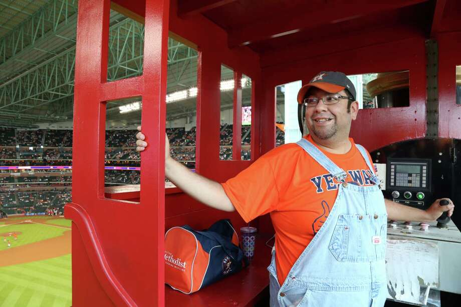 Bobby Vasquez, aka Bobby Dynamite, has the enviable job of conducting the train at Minute Maid Park. Every time the Astros get a home run, Vasquez scoots the train down the track. Photo: Dylan Aguilar, Staff / © 2015 Houston Chronicle