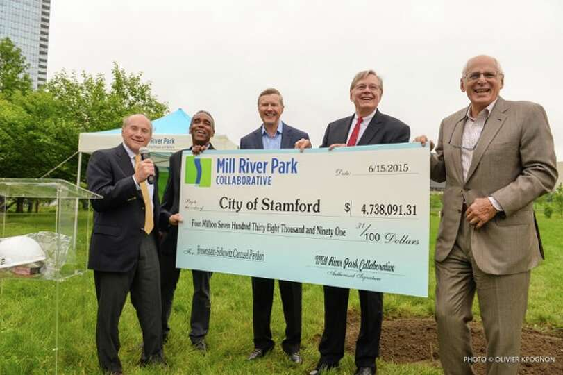 Arthur Selkowitz, Milton Puryear, David Nissen and Don Brownstein recently presented a check to Mayo