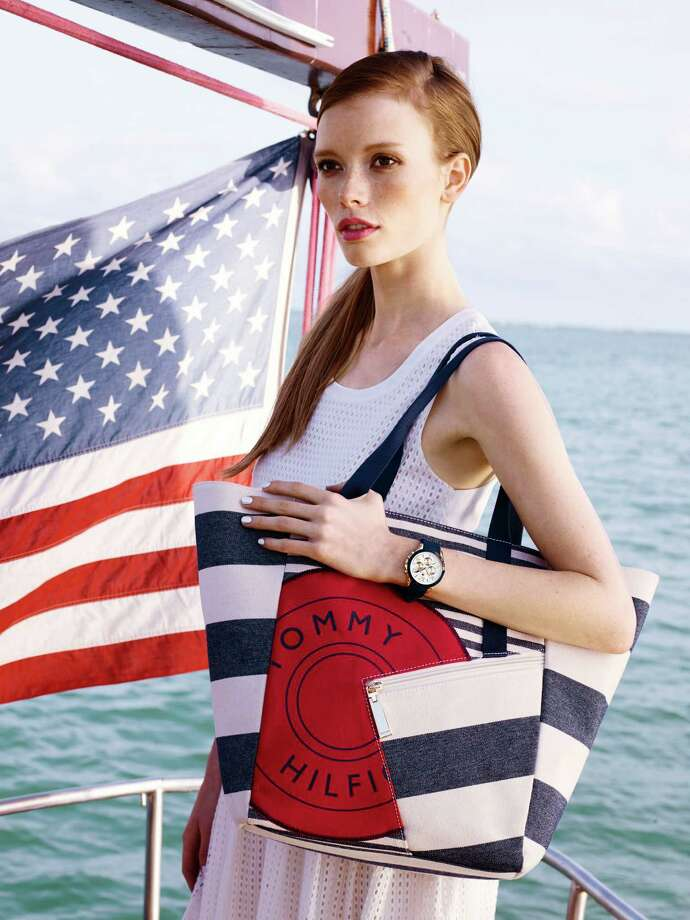 Celebrate July 4 in patriotic style with these accessories from Tommy Hilfiger: rugby stripe tote, $98; multi-eye watch with silicone strap. $155, Macy's. Photo: Courtesy Macy's / San Antonio Express-News