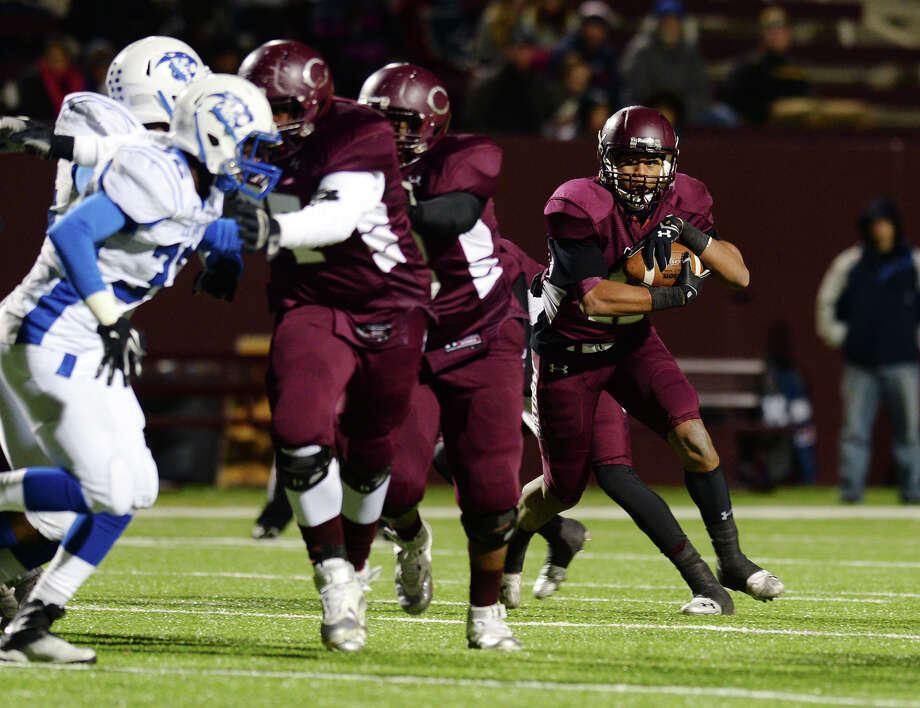 Central's Devwah Whaley, No. 12, looks for a way past the line of scrimmage during Friday's game against C.E. King. The Central Medical Magnet High School Jaguars played against the C.E. King High School Panthers at Clyde Abshier Stadium in Deer Park on Friday night. Photo taken Friday 11/14/14 Jake Daniels/The Enterprise Photo: Jake Daniels / ©2014 The Beaumont Enterprise/Jake Daniels