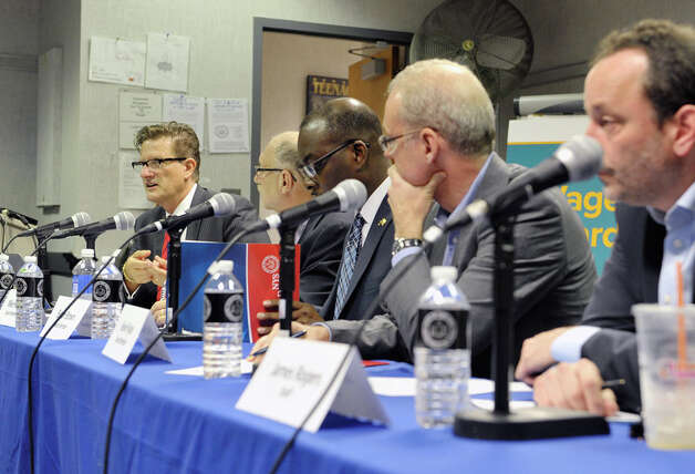 Wage Board, from left to right, Pico Ben-Amotz, staff, Mike Fishman, board member, Byron Brown, board member, Kevin Ryan, board member and James Rogers, staff, take part in a board meeting on Monday, June 29, 2015, in Albany, N.Y. The board is tasked with considering if it should recommend a higher minimum wage for fast-food workers.   (Paul Buckowski / Times Union) Photo: PAUL BUCKOWSKI, Albany Times Union / 00032419A