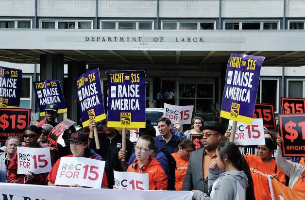 Fast-food workers and their supporters rally outside the Department of Labor, prior to a meeting of the Wage Board on on Monday, June 29, 2015, in Albany, N.Y. The board is tasked with considering if it should recommend a higher minimum wage for fast-food workers.    (Paul Buckowski / Times Union) Photo: PAUL BUCKOWSKI, Albany Times Union / 00032419A