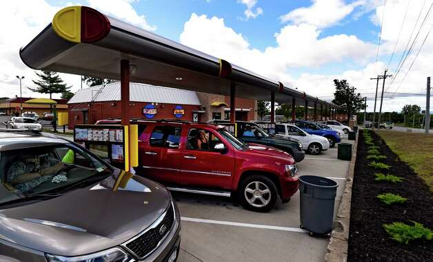 Customers line up under the overhang at the new Sonic Monday, June 29, 2015, during the soft opening of the franchise in Latham, N.Y.  (Skip Dickstein/Times Union) Photo: SKIP DICKSTEIN / 00032420A
