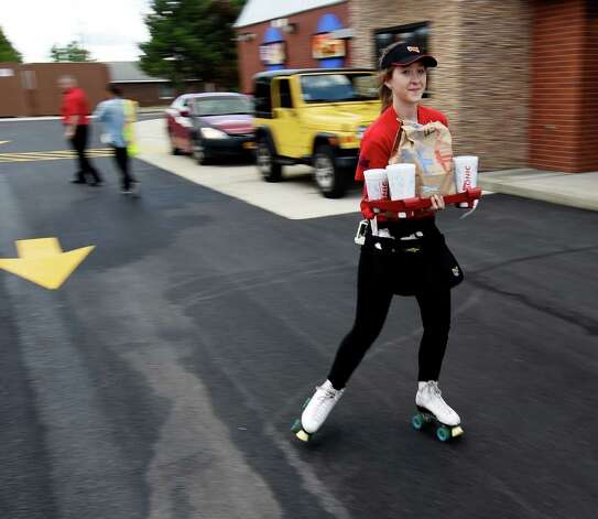 Sophia Filuta, 17, of Troy delivers an order at the new Sonic Monday, June 29, 2015 during the soft opening of the franchise in Latham, N.Y.  (Skip Dickstein/Times Union) Photo: SKIP DICKSTEIN / 00032420A