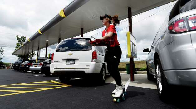 Sophia Filuta, 17, of Troy delivers an order at the new Sonic Monday, June 29, 2015, during the soft opening of the franchise in Latham, N.Y.  (Skip Dickstein/Times Union) Photo: SKIP DICKSTEIN / 00032420A