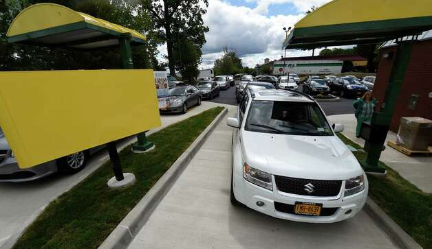 There was a capacity crowd even before the noon lunch hour at the new Sonic Monday, June 29, 2015, during the soft opening of the franchise in Latham, N.Y.  (Skip Dickstein/Times Union) Photo: SKIP DICKSTEIN / 00032420A