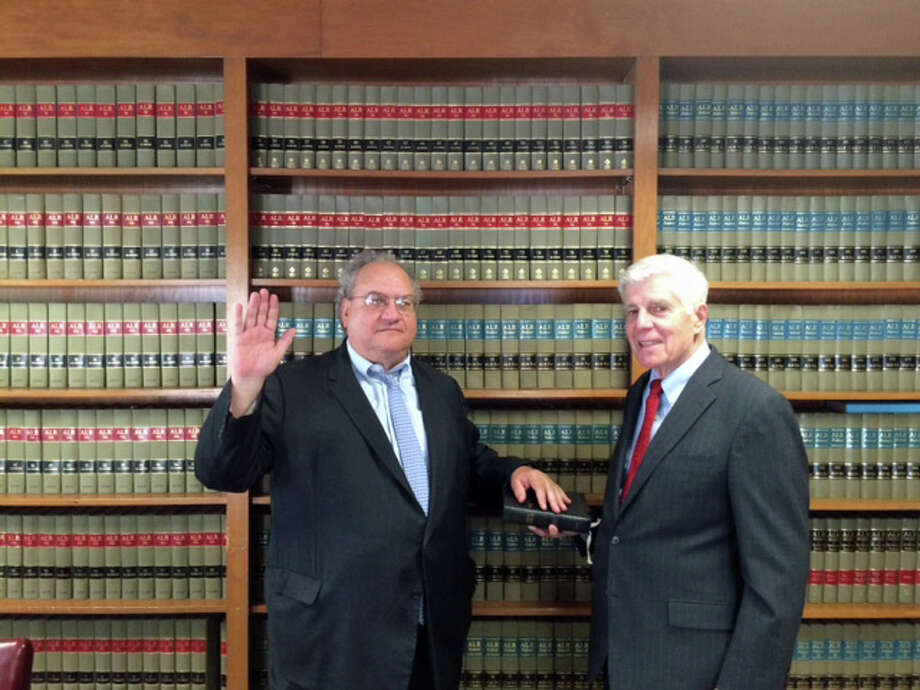 From left, Ed Krumeich II  is being sworn in by  Donat Marchand, a colleague at Ivey, Barnum and O'Mara as well as his mentor. Photo: Contributed / Contributed Photo / Greenwich Time Contributed