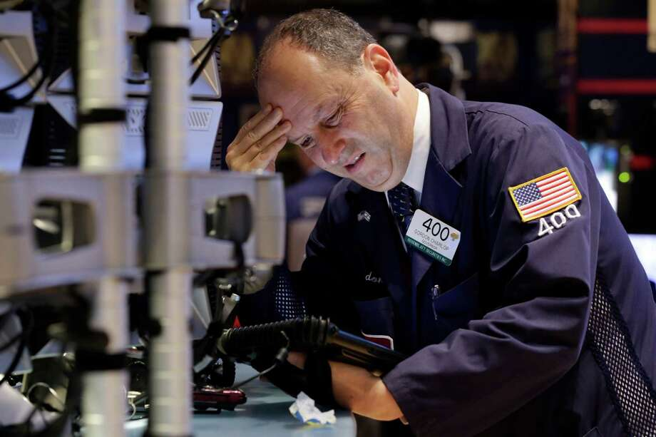 Trader Gordon Charlop works on the floor of the New York Stock Exchange on Monday. Stocks closed with their biggest losses of the year as investors worry about fallout from Greece's worsening debt crisis. Photo: Richard Drew /Associated Press / AP