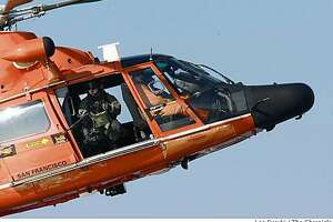 Coast Guard helicopter crash-lands at SFO - Photo