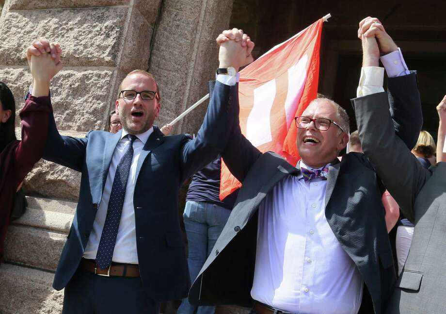 IMAGE DISTRIBUTED FOR HUMAN RIGHTS CAMPAIGN - Human Rights Campaign president Chad Griffin. left, and Jim Obergefell, named plaintiff in the historic U.S. Supreme Court same-sex marriage case, cheer during a press conference held at the Texas Capitol to discuss the local effect of the marriage equality ruling on Monday, June 29, 2015 in Austin, Texas. (Jack Plunkett/AP Images for Human Rights Campaign) Photo: Jack Plunkett, FRE / Associated Press / AP Images
