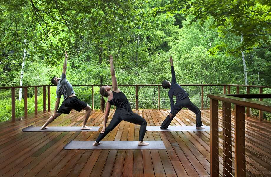 The all-inclusive Twin Farms resort in Barnard, Vt., now offers several varieties of yoga on a new treetop deck as well as yoga hikes through the 300-acre wooded property. Photo: Twin Farms