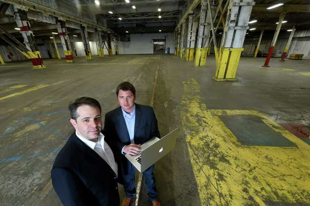 Ari Hoffnung, president and CEO of Fiorello Pharmaceuticals, left and Ryan Cook, general manager of The Clinic inspect the space in the Glenville Industrial and Technology facility Monday afternoon June 29, 2015 in Glenville, N.Y.   This warehouse will house the medical marijuana production facility once approvals are granted to Fiorello.  (Skip Dickstein/Times Union) Photo: SKIP DICKSTEIN / 00032392A