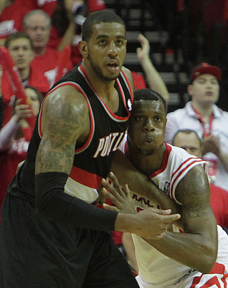Portland Trail Blazers forward LaMarcus Aldridge  left, and Houston Rockets forward Terrence Jones during the second half of game one of the Western Conference Quarterfinals playoff game at the Toyota Center Sunday, April 20, 2014, in Houston.