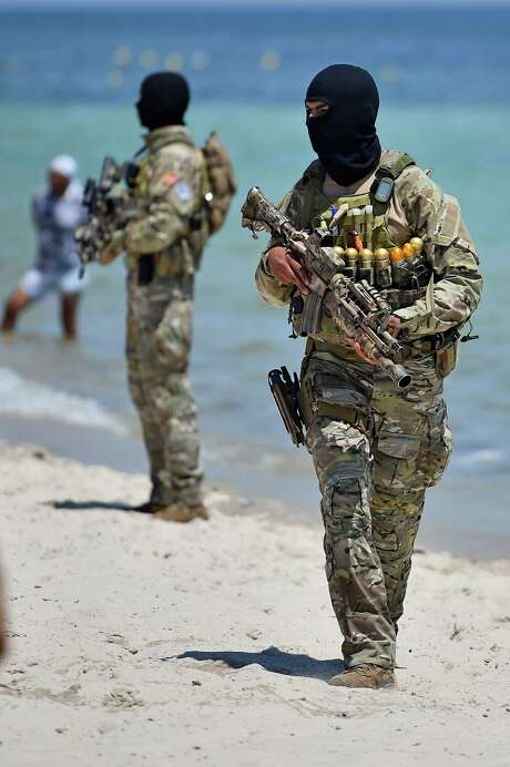 SOUSSE, TUNISIA - JUNE 29:  Armed guards patrol Marhaba beach during a visit by British Home Secretary Theresa May at the scene where 38 people were killed on Marhaba beach last Friday, on June 29, Sousse, Tunisia. British Prime Minister David Cameron has said it has emerged that the British death toll in the Tunisian attack will rise above 30.  (Photo by Jeff J Mitchell/Getty Images) Photo: Jeff J Mitchell, Staff / Getty Images / 2015 Getty Images