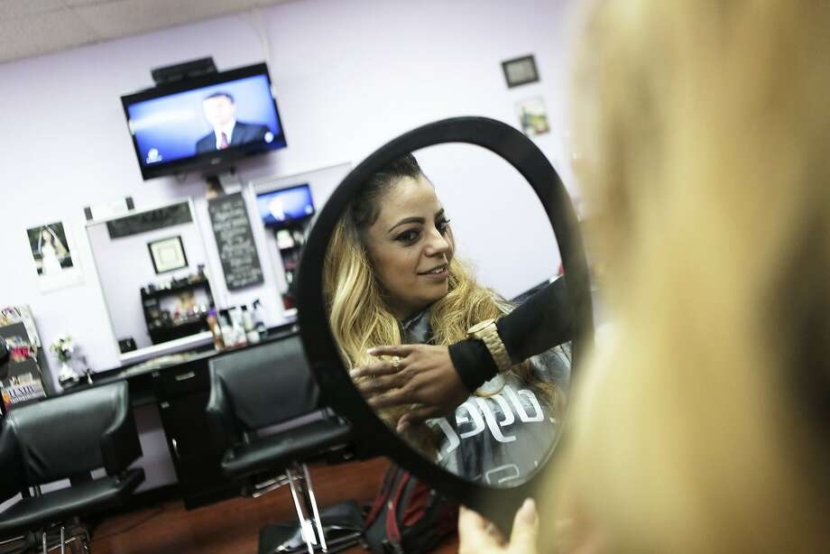 Makeup artist Alyssa Teixeira of Fremont, Ca. looks at her newly applied hair extensions in the mirror on Monday, June 29, 2015 at Destiny Monet Salon in Hayward, Ca.. Destiny Monet of Destiny Monet Salon uses Oakland-based Mayvenn, a start-up company that lets hair stylists sell hair extensions directly to their clients. She says that about 80 percent of her clients come to her salon for hair extensions. Photo: Dorothy Edwards, The Chronicle