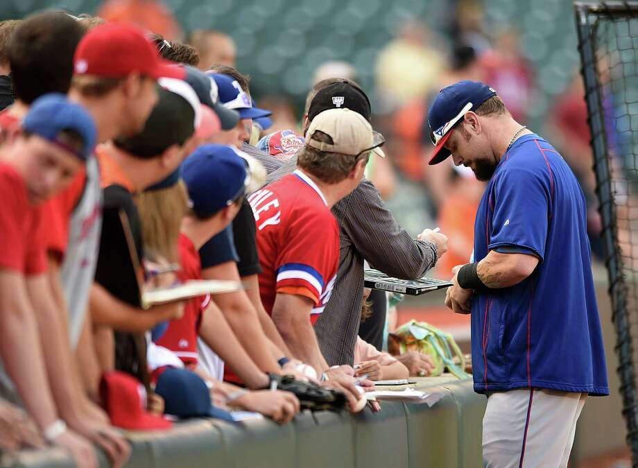 Rangers outfielder Josh Hamilton had lots of time to sign autographs for fans Monday, the day before he is expected to be activated from the disabled list. Photo: Gail Burton, FRE / FR4095 AP