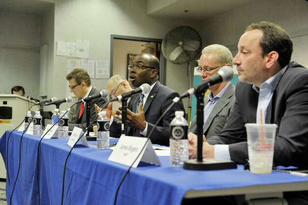 Wage Board, from left to right, Pico Ben-Amotz, staff, Mike Fishman, board member, Byron Brown, board member, Kevin Ryan, board member and James Rogers, staff, take part in a board meeting on Monday, June 29, 2015, in Albany, N.Y. The board is tasked with considering if it should recommend a higher minimum wage for fast-food workers.   (Paul Buckowski / Times Union) Photo: PAUL BUCKOWSKI / 00032419A