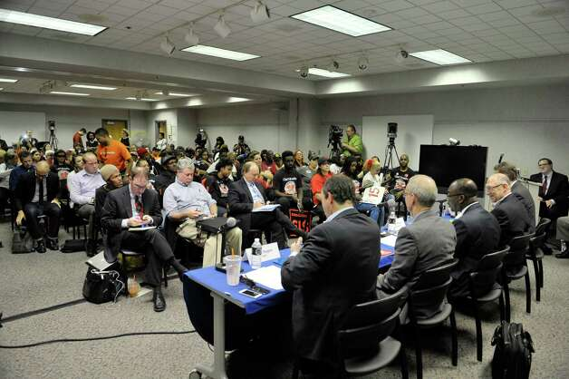 The room is packed as Wage Board members take part in a board meeting on Monday, June 29, 2015, in Albany, N.Y. The board is tasked with considering if it should recommend a higher minimum wage for fast-food workers.   (Paul Buckowski / Times Union) Photo: PAUL BUCKOWSKI / 00032419A