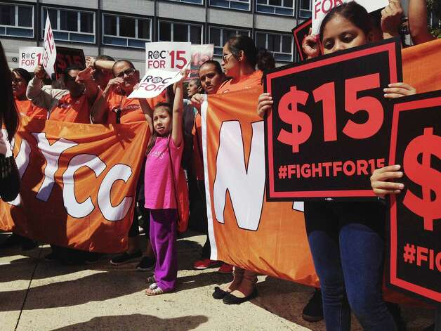 Fast-food workers and their supporters rally outside the Department of Labor, prior to a meeting of the Wage Board on on Monday, June 29, 2015, in Albany, N.Y. The board is tasked with considering if it should recommend a higher minimum wage for fast-food workers.    (Paul Buckowski / Times Union) Photo: PAUL BUCKOWSKI / 00032419A