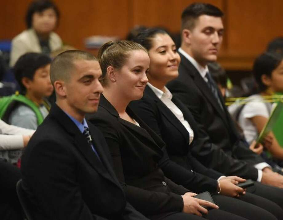 Four new police officers who took the oath of office last month at Town Hall raised the staffing of Greenwich Police Department to 155, its authorized complement of officers. From left, Anthony Bello, Kaitlin Ciarleglio, Ericka Garcia and Jonathan Mirra. Photo: / Tyler Sizemore