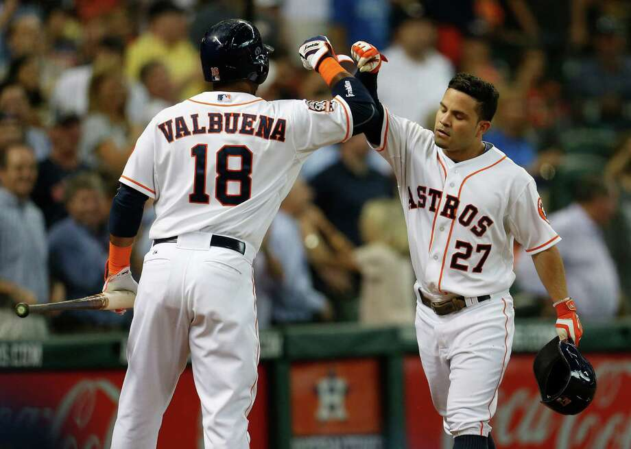 Jose Altuve gives his All-Star candidacy and the Astros' cause a boost with a homer he celebrated with Luis Valbuena. Photo: Karen Warren, Staff / © 2015 Houston Chronicle