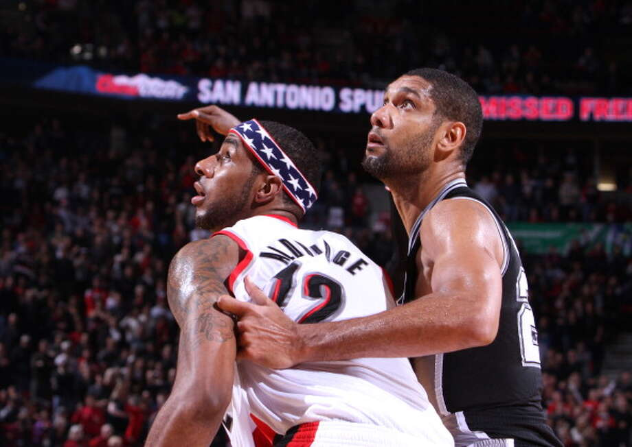 PORTLAND, OR - NOVEMBER 10:  LaMarcus Aldridge #12 of the Portland Trail Blazers fights for position against Tim Duncan #21 of the San Antonio Spurs on November 10, 2012 at the Rose Garden Arena in Portland, Oregon. NOTE TO USER: User expressly acknowledges and agrees that, by downloading and or using this photograph, user is consenting to the terms and conditions of the Getty Images License Agreement. Mandatory Copyright Notice: Copyright 2012 NBAE (Photo by Sam Forencich/NBAE via Getty Images) Photo: NBAE/Getty Images