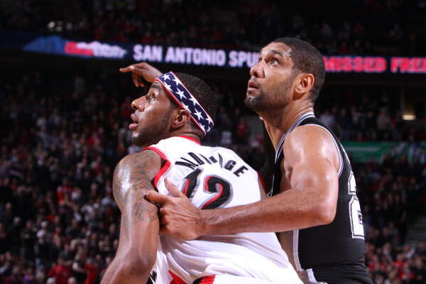 PORTLAND, OR - NOVEMBER 10:  LaMarcus Aldridge #12 of the Portland Trail Blazers fights for position against Tim Duncan #21 of the San Antonio Spurs on November 10, 2012 at the Rose Garden Arena in Portland, Oregon. NOTE TO USER: User expressly acknowledges and agrees that, by downloading and or using this photograph, user is consenting to the terms and conditions of the Getty Images License Agreement. Mandatory Copyright Notice: Copyright 2012 NBAE (Photo by Sam Forencich/NBAE via Getty Images)