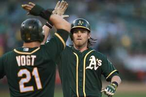 A's use their power to down Rockies - Photo