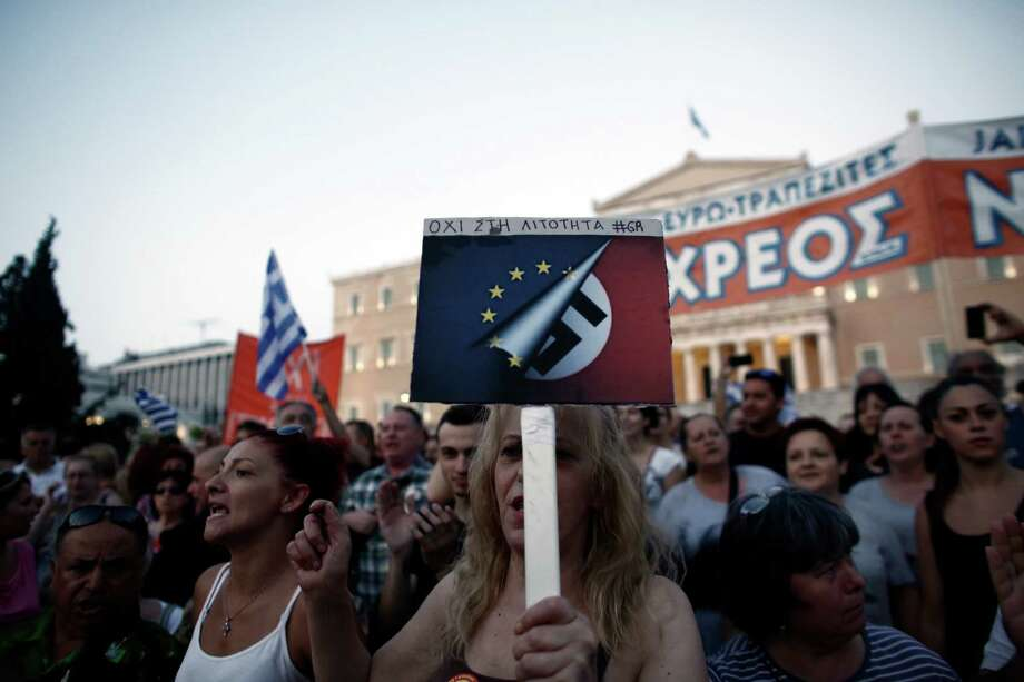 Protesters in Athens hold an anti-austerity demonstration. Grecian Prime Minister Alexis Tsipras says demands for tougher austerity measures aren't acceptable after six years of recession. Photo: Kostas Tsironis /Bloomberg / © 2015 Bloomberg Finance LP
