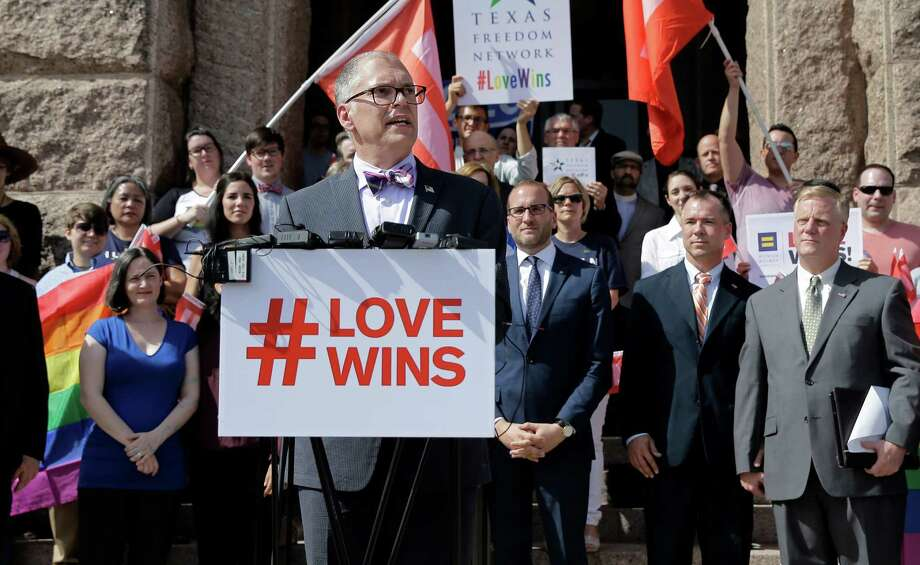 Jim Obergefell, the named plaintiff in the Obergefell v. Hodges Supreme Court case that legalized same sex marriage nationwide, is backed by supporters of the courts ruling on same-sex marriage on the step of the Texas Capitol during a rally Monday, June 29, 2015, in Austin, Texas. The Supreme Court declared Friday that same-sex couples have a right to marry anywhere in the United States. (AP Photo/Eric Gay) Photo: Eric Gay, Associated Press / AP