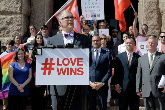 Jim Obergefell, the named plaintiff in the Obergefell v. Hodges Supreme Court case that legalized same sex marriage nationwide, is backed by supporters of the courts ruling on same-sex marriage on the step of the Texas Capitol during a rally Monday, June 29, 2015, in Austin, Texas. The Supreme Court declared Friday that same-sex couples have a right to marry anywhere in the United States. (AP Photo/Eric Gay)