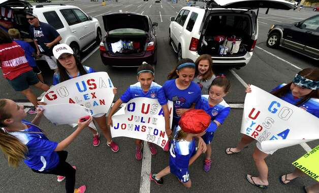 Members of Capital United Soccer Team gather at Crossgates Commons Tuesday morning, June 30, 2015, in Albany, N.Y., as they prepare for a trip to Montreal to watch Team USA Women's soccer compete tonight in the World Cup.  (Skip Dickstein/Times Union) Photo: SKIP DICKSTEIN / 00032412A