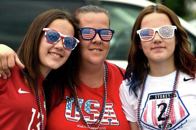 Twins Mickale, left, and Nicolette, 13, flank mom Cathy Knauf of Rotterdam  prepare for a trip to Montreal to watch Team USA Women's soccer compete tonight in the World Cup Tuesday morning, June 30, 2015, at Crossgates Commons in Albany, N.Y. (Skip Dickstein/Times Union) Photo: SKIP DICKSTEIN / 00032412A