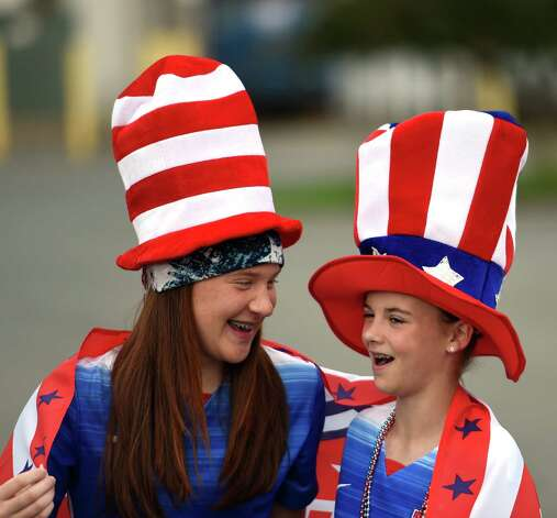Sydney Loux ,12, shares a laugh with Samantha Timpanaro, 12, at Crossgates Commons Tuesday morning, June 30, 2015, in Albany, N.Y., as they prepare for a trip to Montreal to watch Team USA Women's soccer compete tonight in the World Cup.  (Skip Dickstein/Times Union) Photo: SKIP DICKSTEIN / 00032412A