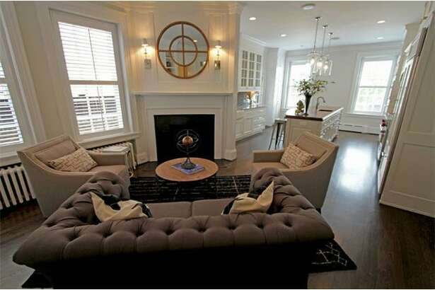"""Newly hired University of Texas men's basketball coach Shaka Smart is selling his Virginia home for $1,495,000. The 3,885-square-foot home is called a """"sanctuary for the 21st Century,"""" according to its listing on Trulia. The three-bedroom home includes 6 bedrooms, 4.5 bathrooms, five fireplaces, hardwood floors throughout, bell-shaped chandeliers and Charleston porches."""