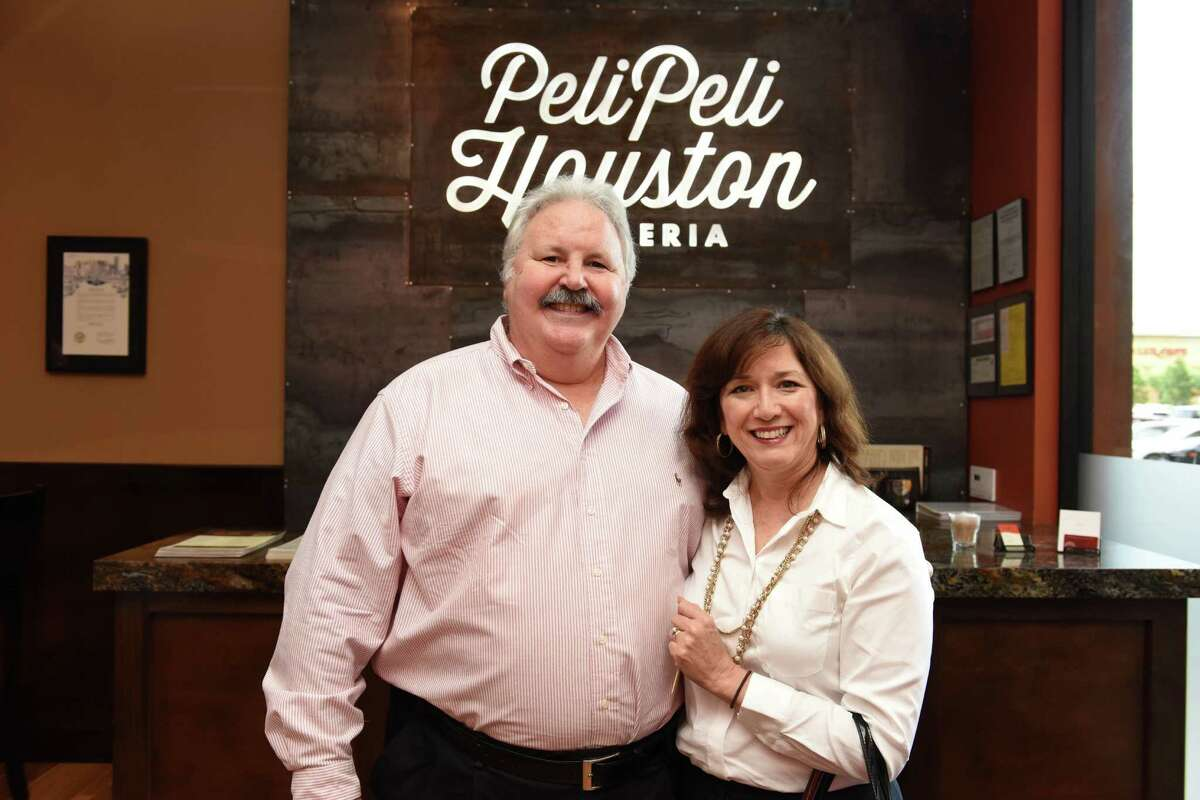 Lanny and Debbi Griffith at George Springer's Bowling Benefit Kickoff Party benefiting SAY at Peli Peli in the Galleria