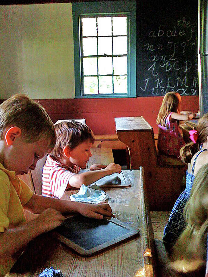 Children taking part in the New Canaan Historical Society's Colonial Day Camp during summer of 2014. The week-long program focuses on a range of activities including games, crafts, and cooking with a focus on life in the Colonies in New England. Photo: Contributed / Contributed Photo / New Canaan News