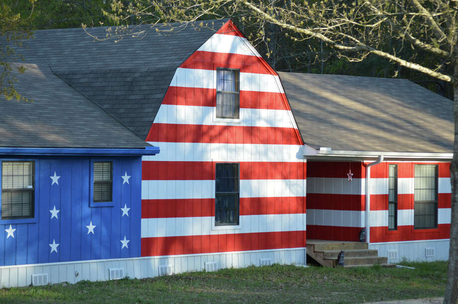 Darien artist and photographer Robert Carley photographed flag-painted homes on his recent travels around the United States. Photo: Contributed / Contributed Photo / Darien News