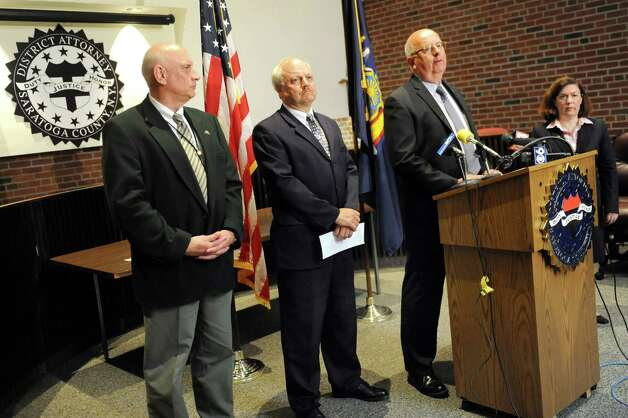 Sheriff Michael Zurlo, second from right, speaks during a news conference on Tuesday, June 30, 2015, at the Saratoga County District Attorney's office in Ballston Spa, N.Y. Richard Laport, 51, of Edinburg died after an encounter with officers. (Cindy Schultz / Times Union) Photo: Cindy Schultz / 00032443A