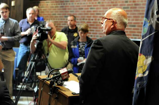 Sheriff Michael Zurlo, right, speaks during a news conference on Tuesday, June 30, 2015, at the Saratoga County District Attorney's office in Ballston Spa, N.Y. Richard Laport, 51, of Edinburg died after an encounter with officers. (Cindy Schultz / Times Union) Photo: Cindy Schultz / 00032443A