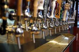 A row of beer taps at Dirty Water in San Francisco, California, on Tuesday, June 23, 2015. The bar will have more than 50 beers on tap.