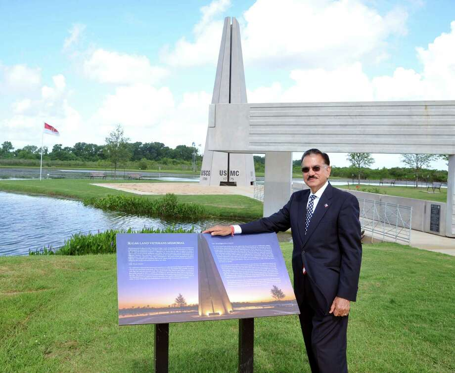 Sunil Sharma, president of the Sugar Land Legacy Foundation, visits the park memorial. The foundation is raising funds to add 100 pavers to the site. Photo: Eddy Matchette, Freelance / Freelance