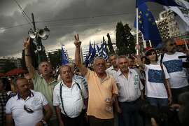 People shout slogans during a rally by demonstrators of the YES vote to the upcoming referendum, at Syntagma Square in Athens, Tuesday, June 30, 2015. Greece is set to become the first developed nation to not pay its debts to the International Monetary Fund on time, as the country sinks deeper into a financial emergency that has forced it put a nationwide lockdown on money withdrawals. (AP Photo/Daniel Ochoa de Olza)